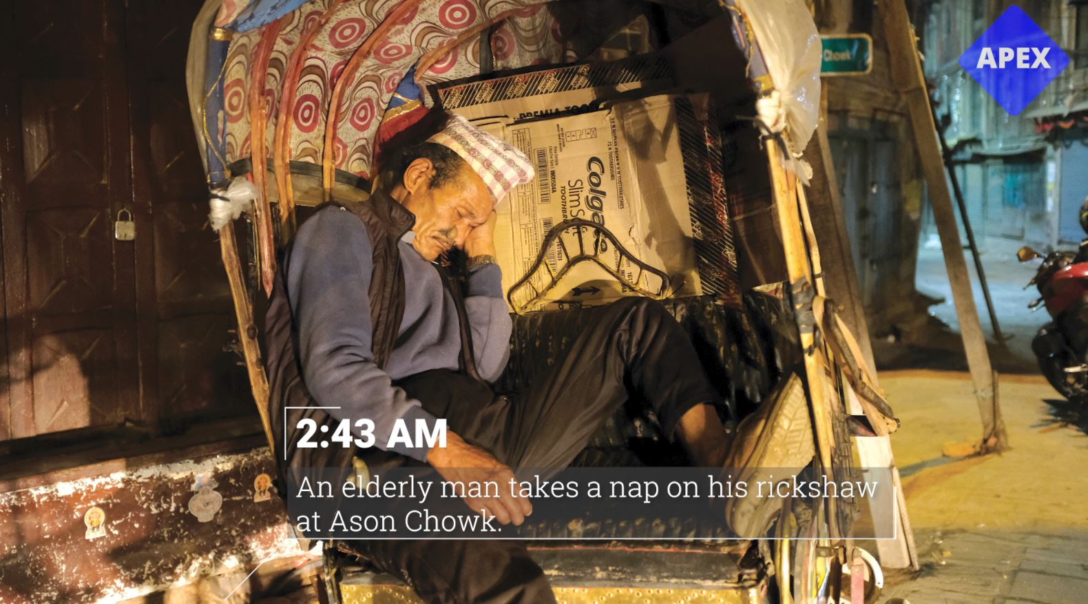 An elderly man takes a nap on his rickshaw at Ason Chowk. (2:43 am)